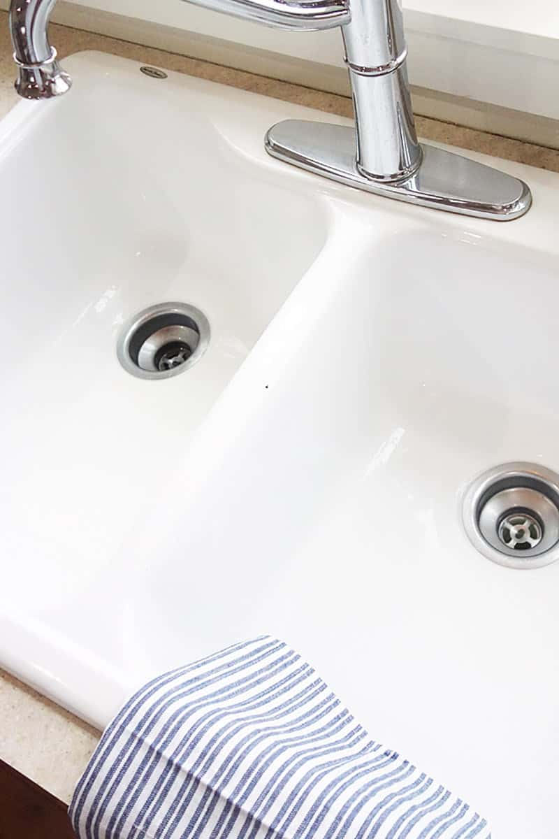 a clean and shining bright white kitchen sink