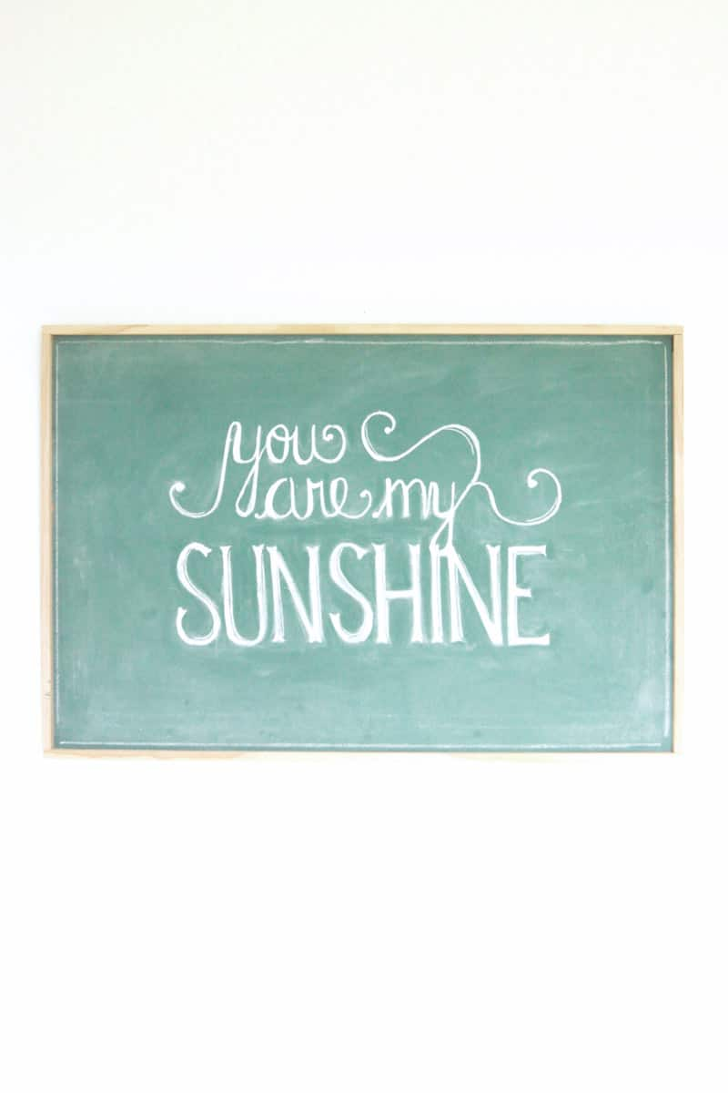 a vintage green chalkboard that says you are my sunshine
