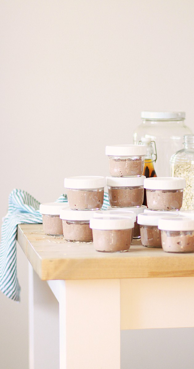 a stack of mason jars full of homemade snacks
