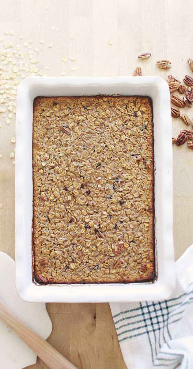 a fresh baked casserole dish of banana baked oatmeal with pecans and chocolate chips