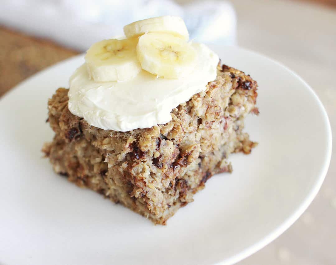 a piece of banana baked oatmeal with cream cheese and bananas on top