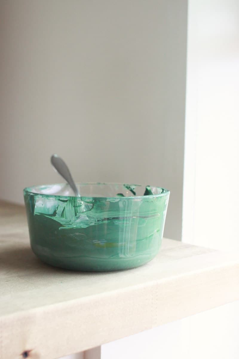 a bowl of green paint