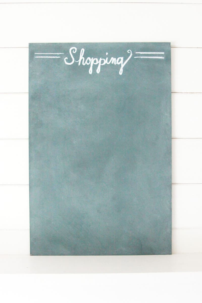 a homemade chalkboard with a shiplap backdrop