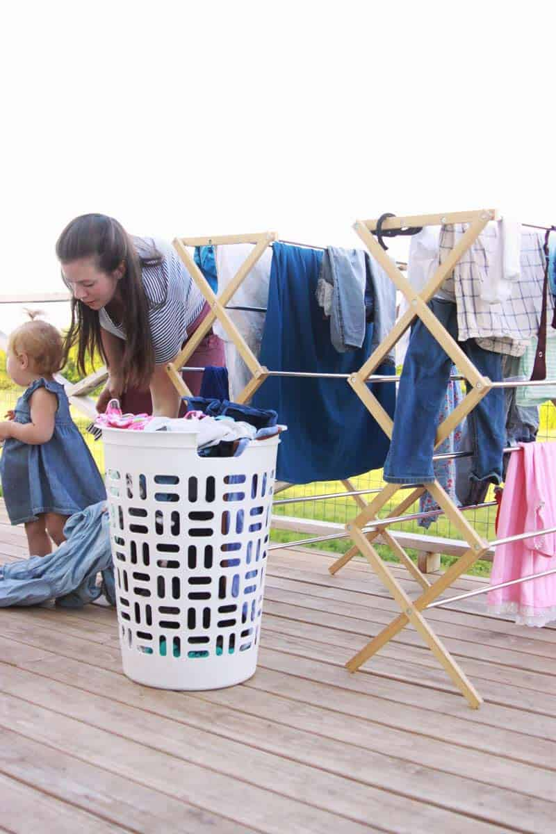 a mom and her baby doing laundry together