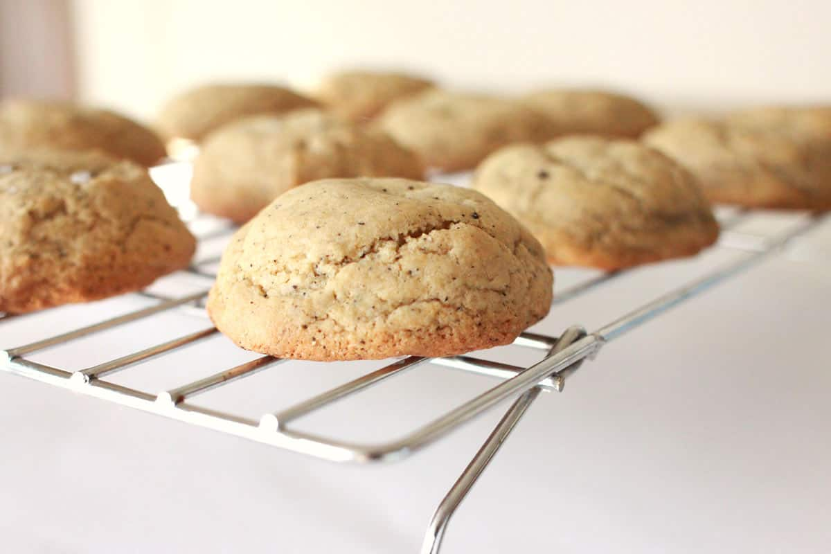 thick cookies on a wire rack with coffee grounds in the dough