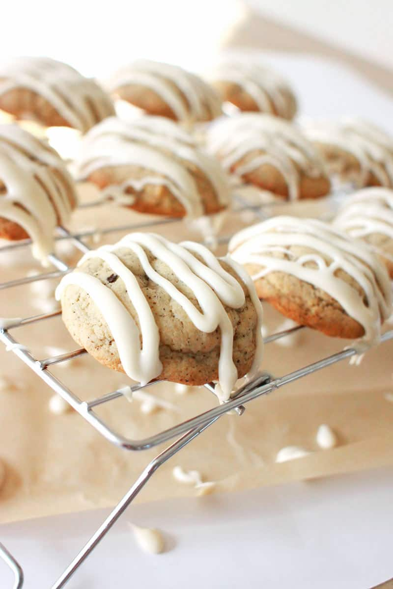 thick soft cookies with coffee grounds in the dough. Icing is drizzled on top.