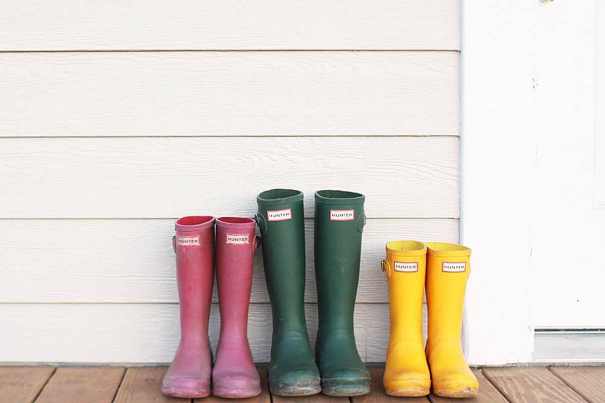 3 pairs of muddy kids hunter rain boots