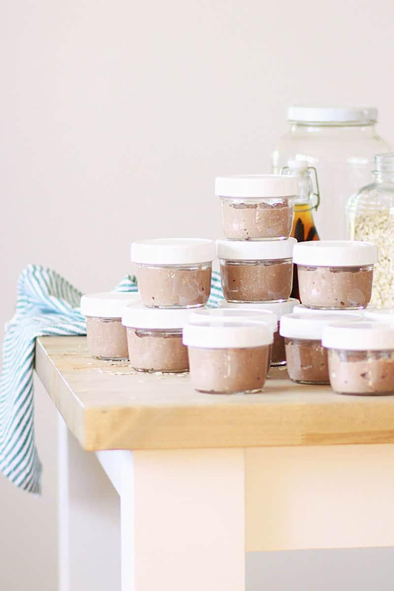 mason jars with lids full of chocolate overnight oats