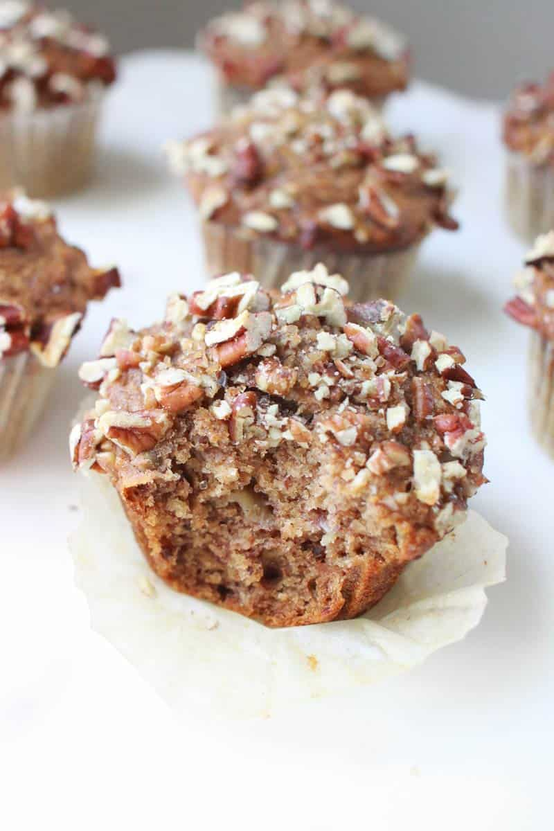 banana nut muffins on a white marble cutting board