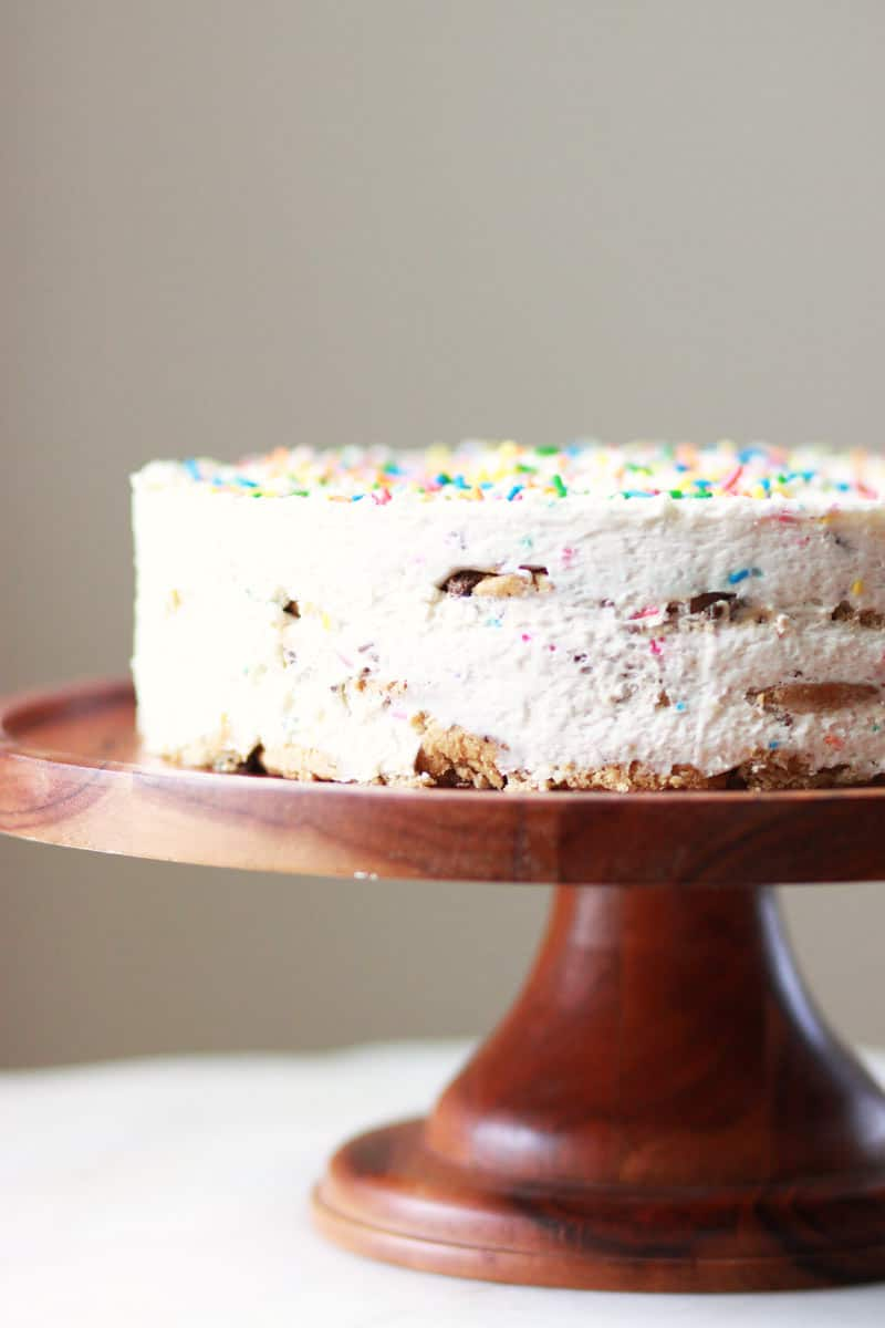 a funfetti ice box cake on a wooden cake stand