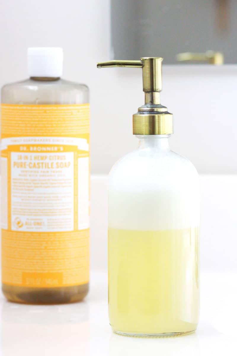 a bottle of orange castile soap and a bottle of foaming face soap