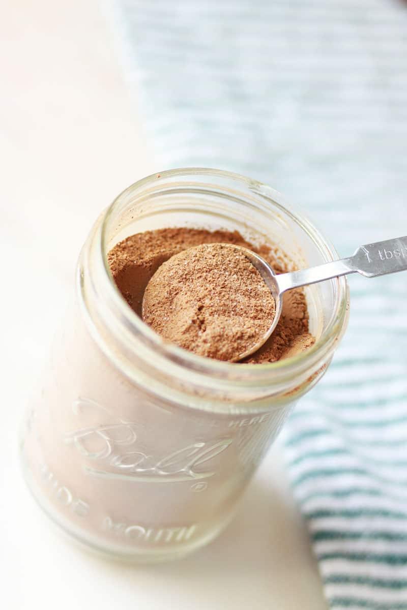 a tablespoon of homemade cocoa mix in a mason jar