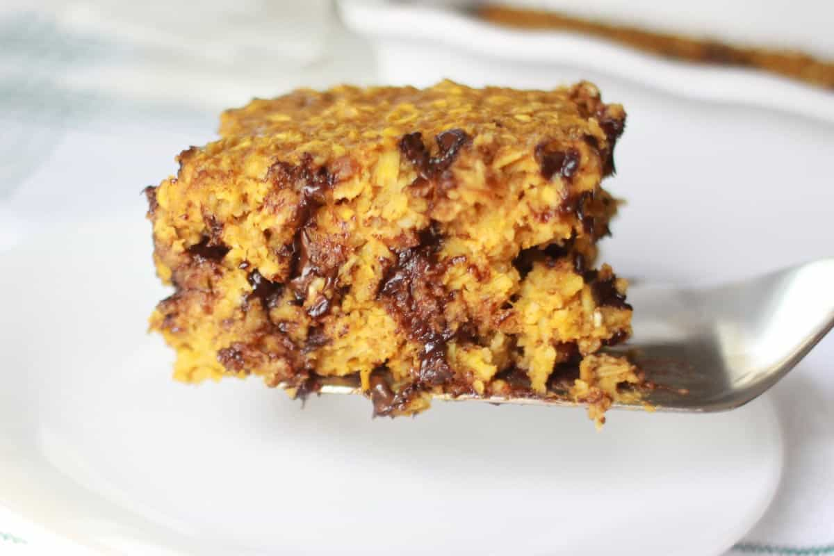 a serving of pumpkin baked oatmeal with chocolate chips in it