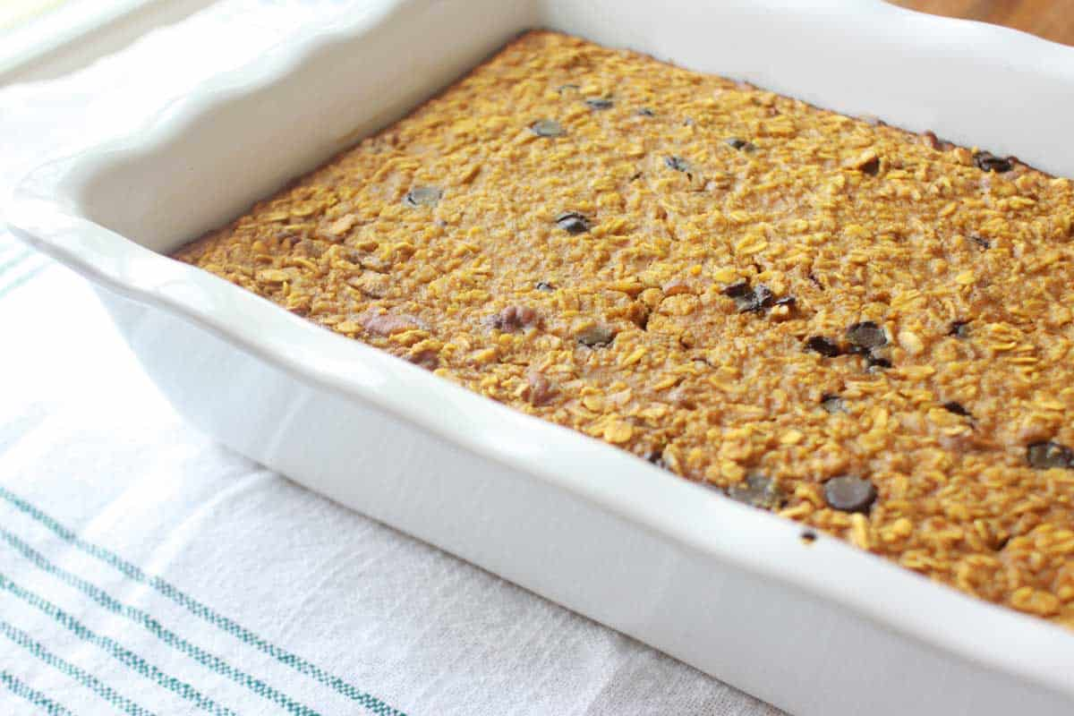 a casserole dish of pumpkin baked oatmeal with chocolate chips in it